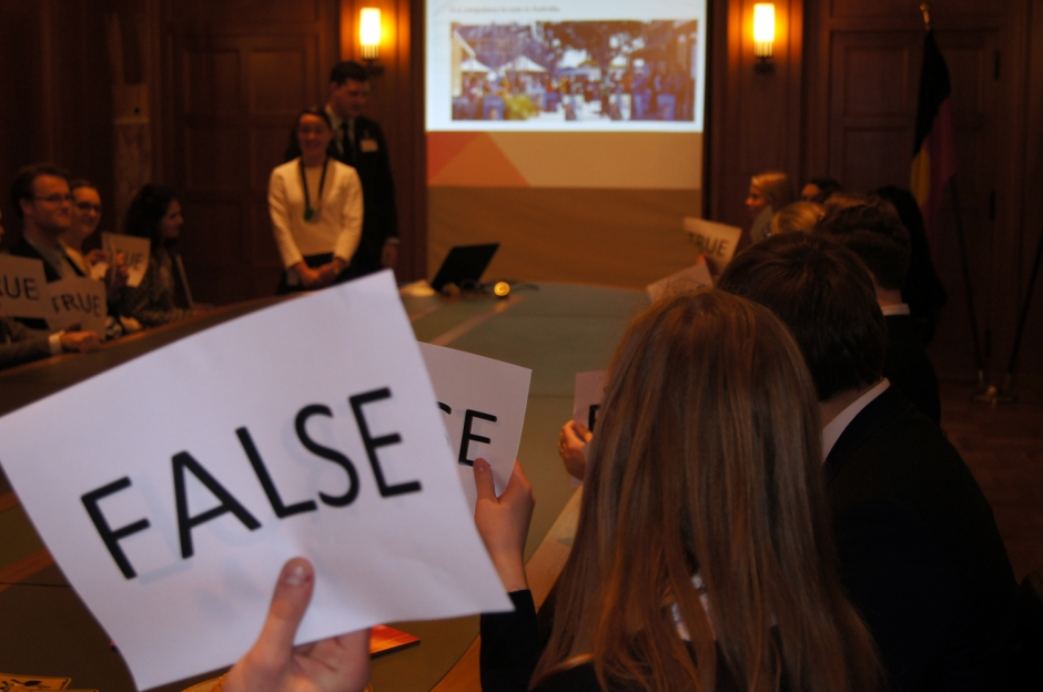 "During a game of ""True and False"": Someone holding a ""False Sign"""