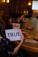 "During a game of ""True and False"": Someone holding a ""True Sign"""